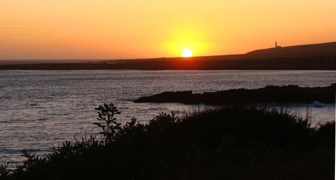 the sun falls into the sea